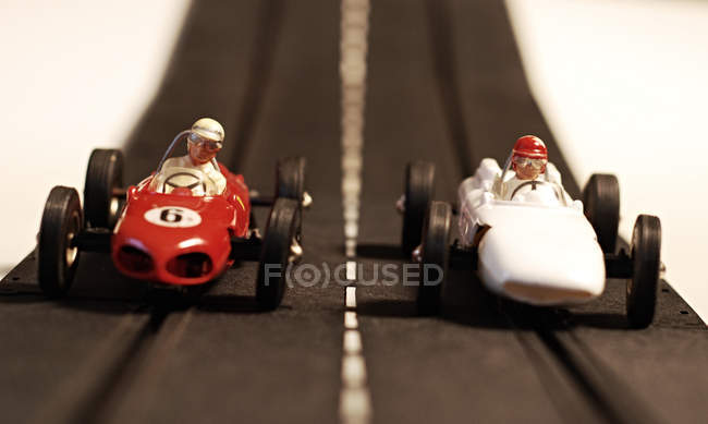 Sportive toy cars on race road — Stock Photo
