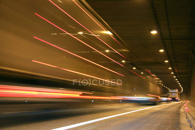 Highway road, tunnel road traffic with track lighting — Stock Photo