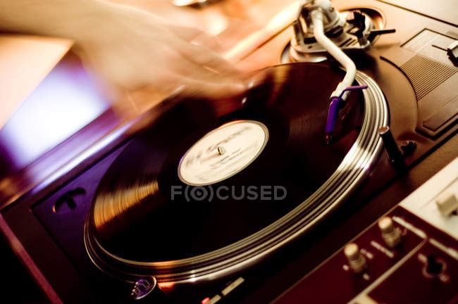 Dj man scratching vinyl record — Stock Photo