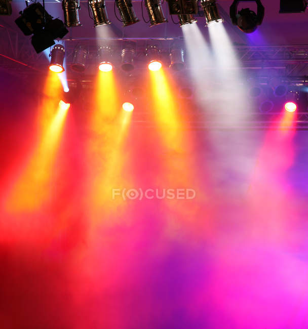 Illuminated colorful stage lamps — Stock Photo