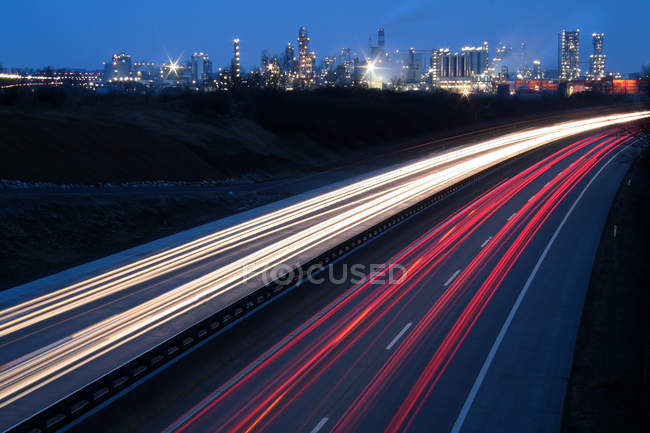 Highway road with double lanes, motion and speed track lighting, blurred motions — Stock Photo