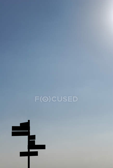 Footpath signs against blue clear sky with sunshine — Stock Photo