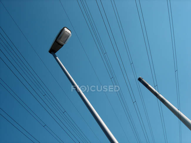 Lantern and smoke stack with power lines — Stock Photo