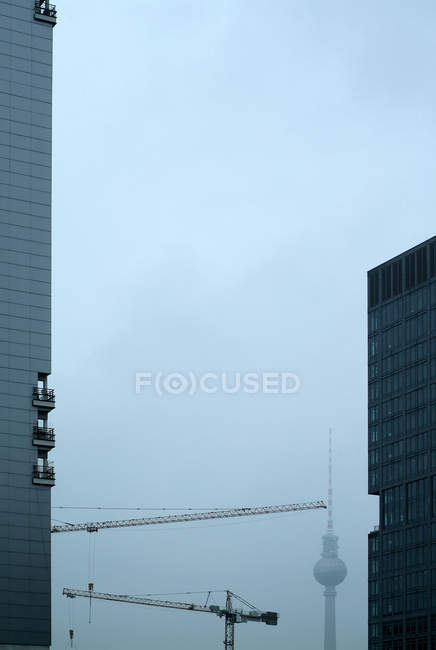 Office buildings  in Berlin and television tower in fog — Stock Photo