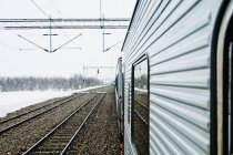 Train at snow in winter — Stock Photo