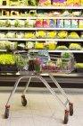 Goods in metal shopping cart at supermarket — Stock Photo