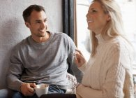 Happy young couple spending quality time at cafe — Stock Photo