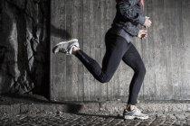 Full length of man running in tunnel — Stock Photo