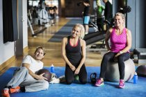 Portrait of friends relaxing at health club — Stock Photo