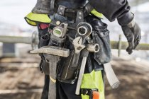 Midsection of construction worker wearing tool belt at site — Stock Photo