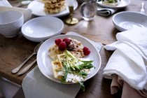 Close-up of food on plate at wooden table — Stock Photo