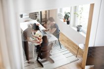 High angle view of family having breakfast at dining table — Stock Photo