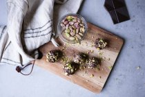High angle view of chocolate pistachio truffle on cutting board at kitchen counter — Stock Photo