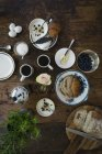 Directly above view of breakfast on wooden table — Stock Photo