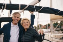 Portrait of smiling senior couple standing in yacht — Stock Photo