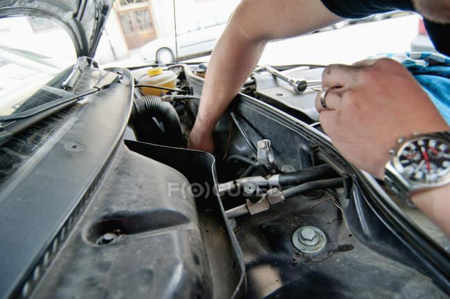 Close-up of man repairing car vehicle — Stock Photo