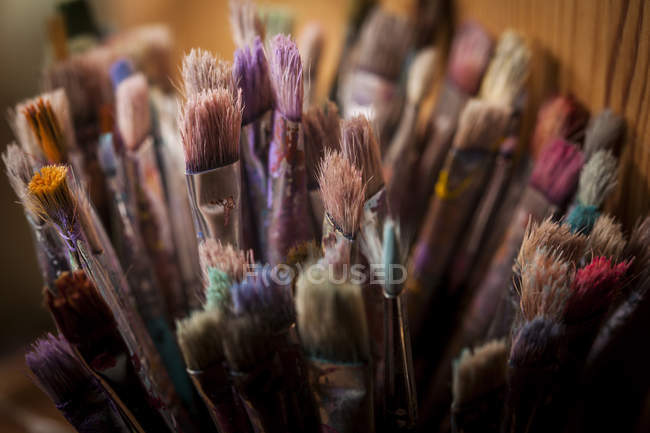 Various old paint brushes at home — Stock Photo
