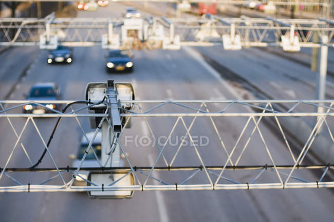 View of constructions with surveillance cameras over roadway — Stock Photo