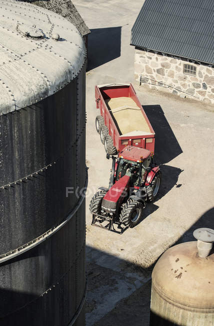 High angle view of tractor with trailer full of grains — Stock Photo