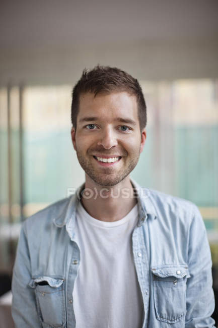 Portrait of happy young Caucasian man smiling — Stock Photo