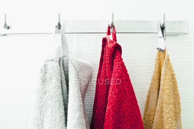 Towels Hanging In A Row On Hooks Still Life Three Objects Stock Photo 205860586