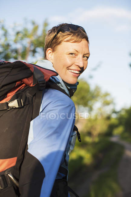 Portrait of female hiker smiling outdoors — Stock Photo