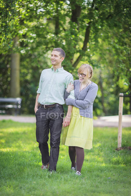 Full length of couple walking together in park — Stock Photo