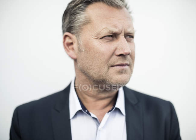 Mature businessman looking away against clear sky — Stock Photo