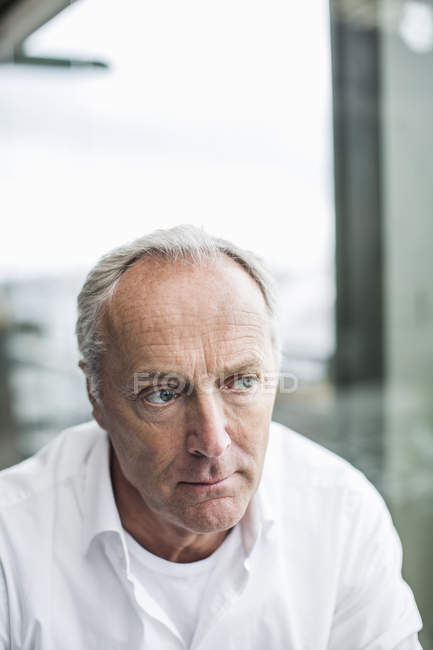 Pensive mature businessman looking away — Stock Photo