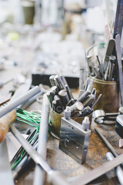 High angle view of various tools in container on workbench at jewelry workshop — Stock Photo