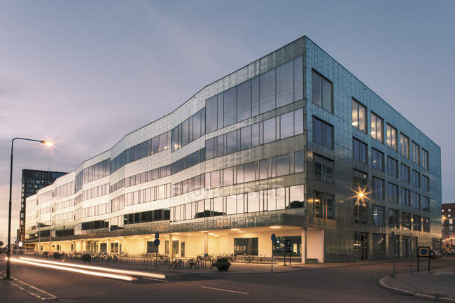 Modern glass building against sky during dusk — Stock Photo