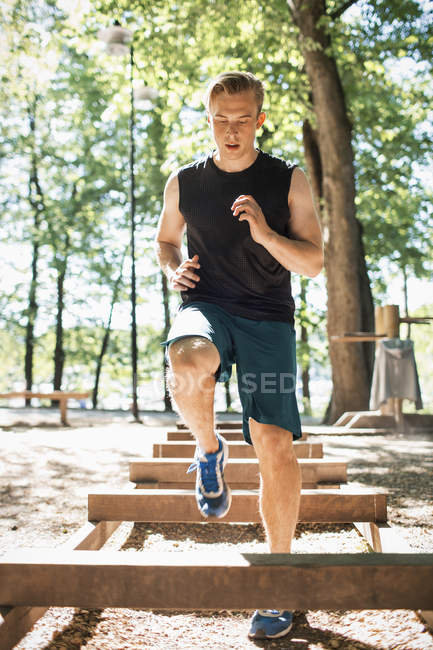 Full length of man exercising at outdoor gum — Stock Photo