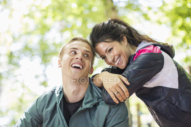 Happy multi-ethnic fit couple outdoors — Stock Photo