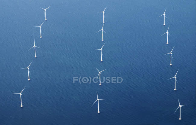 Rows of wind turbine in blue sea, aerial view — Stock Photo