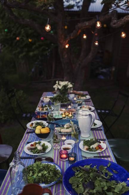 High angle view of food served on dining table outdoors — Stock Photo