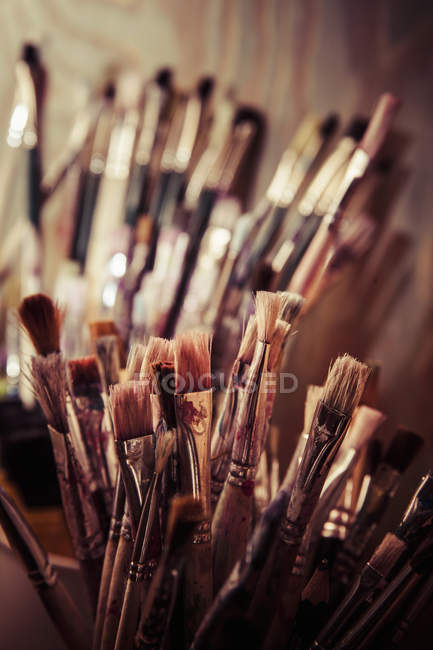 Close-up view of artistic paintbrushes with blurred background — Stock Photo