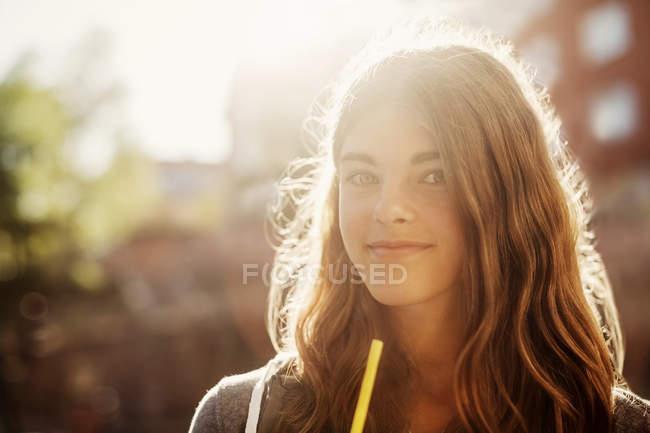 Portrait of smiling teenage girl outdoors — Stock Photo