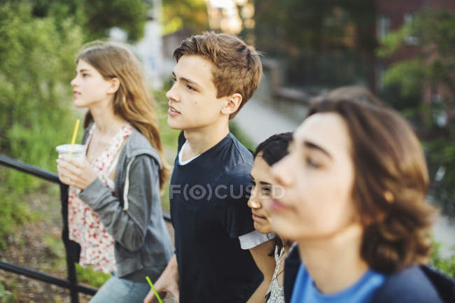 Teenagers moving up steps outdoors — Stock Photo