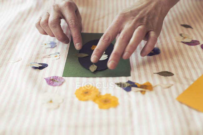 Cropped image of woman making paper craft product on table — Stock Photo