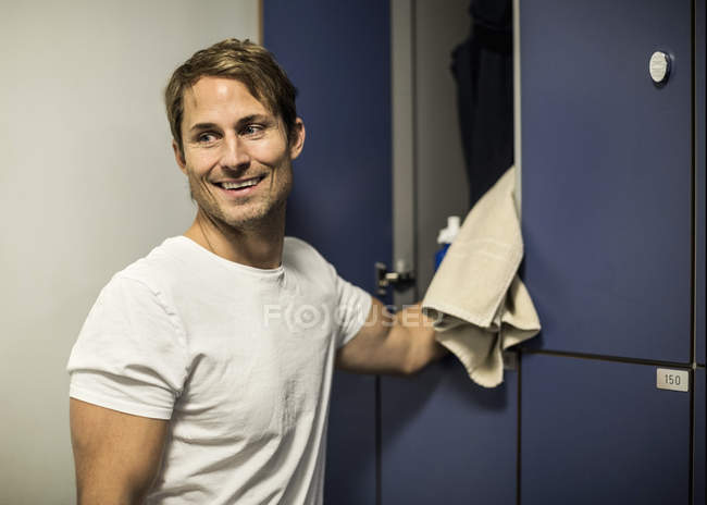 Happy man locker room at health club — Stock Photo