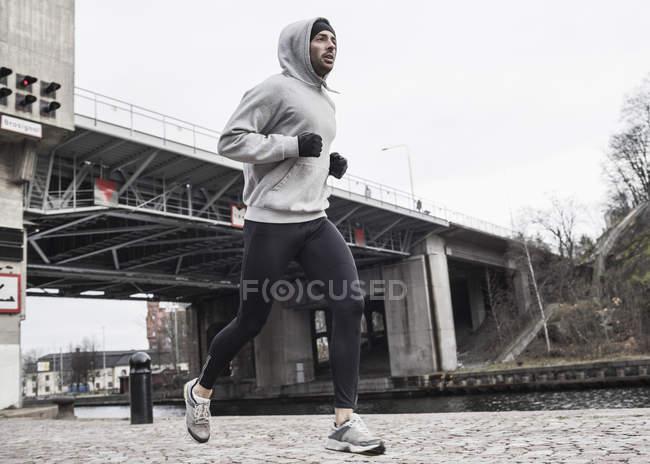 Full length of man jogging on street — Stock Photo