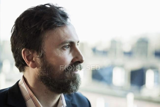Thoughtful businessman looking away outdoors — Stock Photo