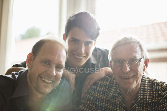 Portrait of three generation family smiling together at home — Stock Photo