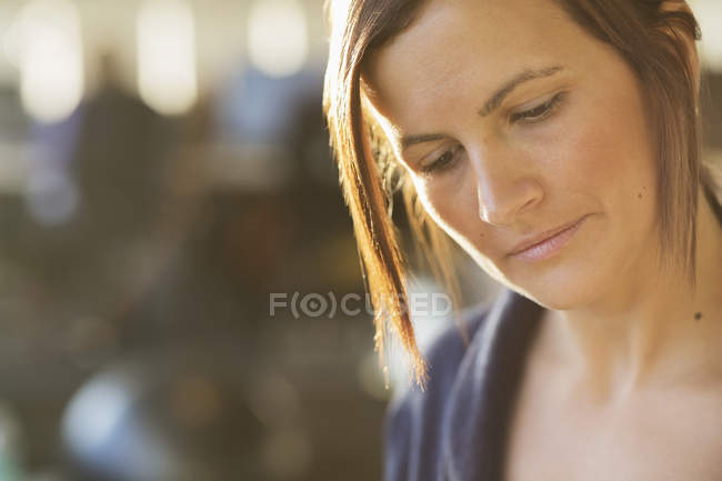 Businesswoman looking down in office — Stock Photo