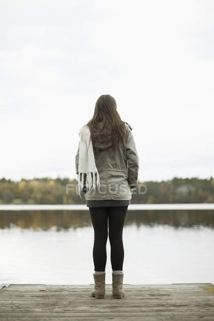 Rear view of woman standing on pier — Stock Photo