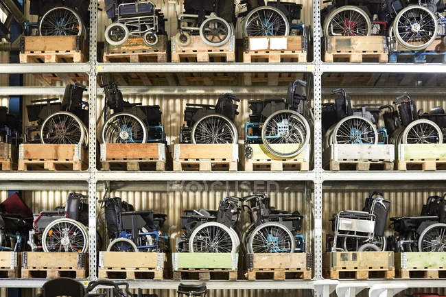 Full frame shot of wheelchairs on rack at warehouse — Stock Photo