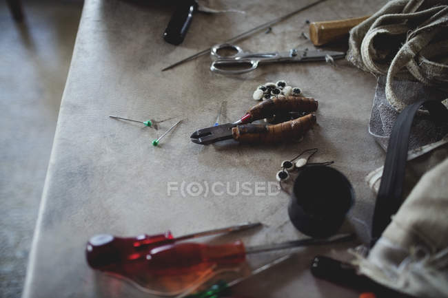 High angle view of various tools on table at workshop — Stock Photo