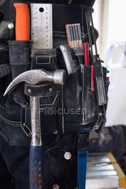 Midsection of construction worker wearing tool belt — Stock Photo