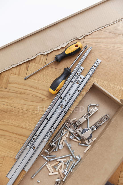 High angle view of carpentry tools on hardwood floor — Stock Photo