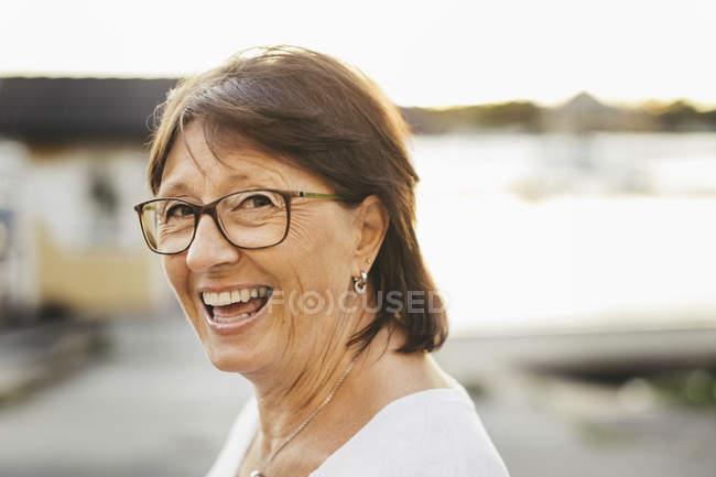 Portrait of confident senior woman smiling outdoors — Stock Photo